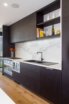 Sleek modern kitchen, bar and laundry with views to die for… Cookbook Storage, Bbq Area, St Kilda, Black Kitchens, Pent House, Dining Area, Kitchen Design, Kitchen Cabinets, House Design