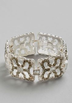 Intriguing Introduction Bracelet. As you extend your silk-gloved hand to greet captivating ballroom guests, you cant help but watch them marvel at the sparkling bracelet elegantly adorning your wrist! #silver #wedding #bridesmaid #bride #modcloth