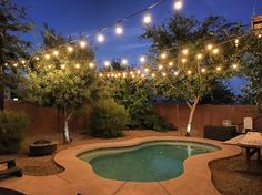 String lights in the backyard over the pool will help with night 18 backyard lighting ideas how to hang outdoor string lights aloadofball Choice Image