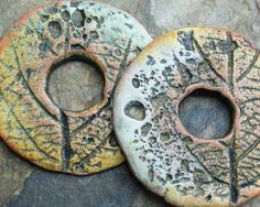 Polymer clay rustic, organic, donut disc beads with natural patterns in shades of blue-green and gold. Metallic copper overtones.