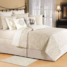 Refresh your master suite or guest room with this charming cotton quilt, showcasing a neutral scrolling motif.   Product: Quilt...