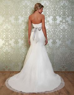 GAYNOR The lace up back gives a perfect fit and sweeps down into the fishtail skirt with a full train. https://www.wed2b.co.uk/vintage-wedding-dresses/viva-bride-gaynor.php