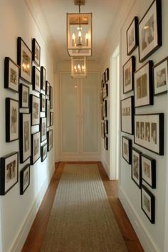 Herlong Associates - entrances/foyers - hallway art, hallway gallery wall, hall gallery wall, photo gallery wall, black and white photogra. Hallway Walls, Long Hallway, Upstairs Hallway, Hallway Art, Dark Hallway, 1930s Hallway, Narrow Hallways, Hallway Pictures, Hanging Pictures