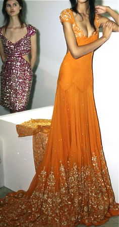Orange gown with gold embroidery detail