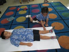 Tracing and decorating our bodies to explore who we are Picnic Blanket, Outdoor Blanket, Our Body, Bodies, Kindergarten, Kids Rugs, Explore, Decorating, Learning