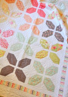 Hugs -- Fig Tree Quilts - would be easy to piece I think, little matching needed, and would feature wonderful fabrics!