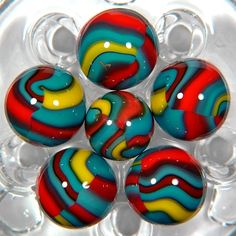 Peltier Superman marbles - tough to find in the wild! (Or Carl's polymer re-makes?)