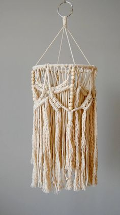 Modern macramé lantern / baby mobile. Perfect boho accent piece for the corner of any room from nursery to living room. Add a hanging lamp light cord (LED bulb recommended, if using a light cord) or hang it by itself. Made with 100% cotton rope. • Approximate Dimensions: Length: