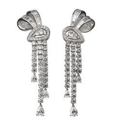 Boucheron Boucles d'oreilles Ava Nœud http://www.vogue.fr/joaillerie/shopping/diaporama/pendants-du-soir-1/10881/image/650044#boucheron-boucles-d-039-oreilles-ava-noeud