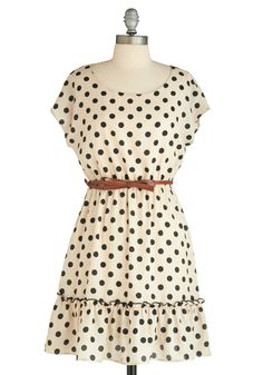 You can take the girl out of the country, but you can't take the country out of the girl. With a precious ruffled hem and tan bow belt, this ivory- and black-spotted dress is not your average polka dotted piece.