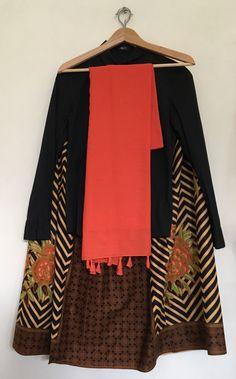 Batik skirt with black shirt and orange hijab