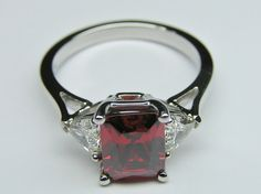 European Engagement Ring - Emerald Cut Ruby Gemstone with trillion diamonds sides in 14K White Gold - ER275