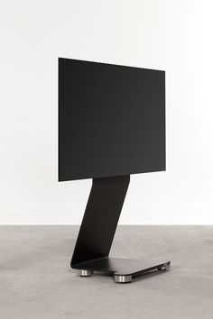 """TV Stand / Ständer    This TV holder is a free-standing model available with integrated concealed casters upon request.   Rear-side concealed cable management. Height of center of TV screen approx. 100 cm  (from floor)  Dimensions (h x w x d):      115 x 52 x 38 cm (for TV screens from 40"""" to 65"""", 50 kg)  Material:      painted steel with fine textured finish, in matt black, white or aluminum silver  Options:      a selection of RAL colors     holder for Sound Bar system or center speaker…"""