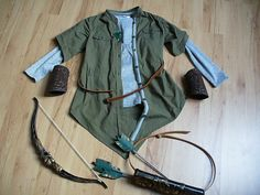 Legolas elf easy DIY costume : - green military style dress cut to the proper shape - cheap plastic bow , customed arrows -