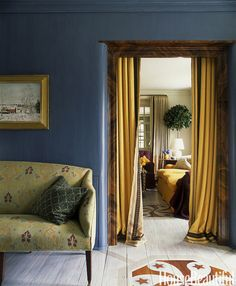 For the entrance hall of a Pennsylvania farmhouse, designer Jeffrey Bilhuber chose a regal blue, based on a color he had seen at Mount Vernon. A 1920s settee is covered in Le Gracieux's Kirachi.   - HouseBeautiful.com