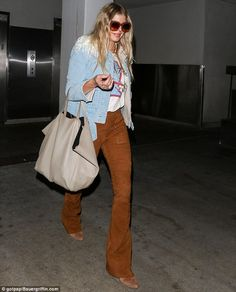 Arriving home: Fergie flew into LAX in the early hours of Thursday morning Wednesday dress...