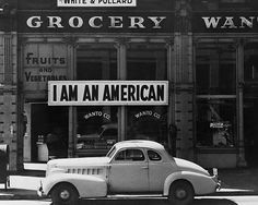 I Am an American, Oakland, CA, March 1942 by Dorothea Lange