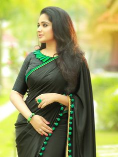 A classic in black with a flavor of turquoise pom-poms. The saree is teamed with a jacket style blouse with pleated frills in turquoise along the right side neckline. Fancy Blouse Designs, Blouse Neck Designs, Sari Bluse, Indische Sarees, Saree Jackets, Saree Blouse Patterns, Blouse Models, Saree Shopping, Saree Dress
