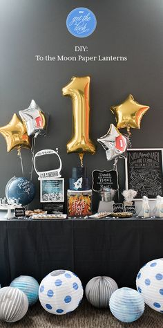 Take your guests to the moon and back with party décor that is truly out of this world. Be inspired by this first birthday party for a sweet little astronaut and create your own galaxy of planets using white paper lanterns, tissue paper and paint.