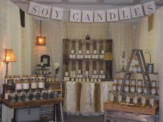 Beautiful set up for candles in a craft fair booth. Nicely organized and good use of props.