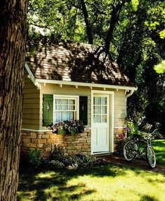 Cottage-Cozy Shed: Stacked stone walls, clapboard siding, and shutters with pine-tree cutouts! Would be so adorable as a play house or a guest house