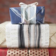 Use specialty marbled paper, ribbon, and twine to make these beautiful layered wrapping papers. Time to spruce up those gifts!