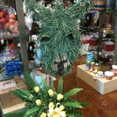 Customer requested a donkey for a funeral standing spray. Here's the results. NV florist, Paducah, Ky