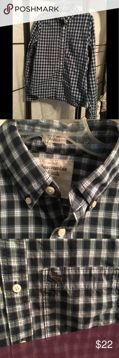 Abercrombie and Fitch muscle fit button down Blue plaid muscle fit button down by Abercrombie and Fitch. Comfortable and stylish, casual or dressy! Abercrombie & Fitch Shirts Dress Shirts