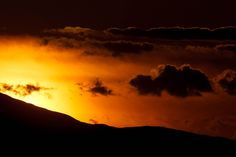 (Trent Nelson  |  The Salt Lake Tribune)  The sun sets behind the red rock above Moab, Wednesday April 3, 2013.