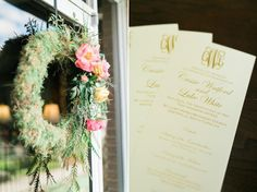 Southern wedding decor inspiration with flowers and monogram programs. Photo by Charleston wedding photographer Catherine Ann Photography