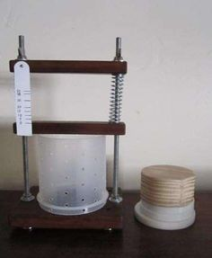 An excellent, simple DIY cheese press for hard cheeses from cheap materials.
