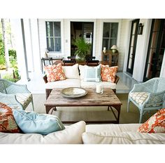 Love this porch by Elizabeth Newman Interior Design.  Nice color palette, great side chairs, decorated like an indoor living room.