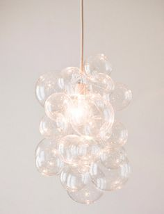 Bubble balls, fishing line, silver wire and ceiling hooks are all you need to build a bubble chandelier.