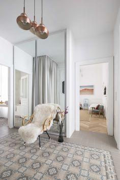 Clean scandi-style apartment located in Vienna, Austria, designed by Destilat. Scandi Style, Old Building, Modern Times, Design Studio, Stores, Neutral Colors, Oversized Mirror, Architecture Design, Flooring