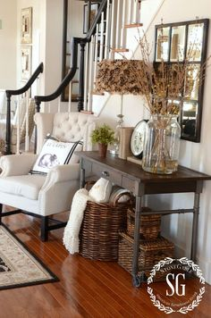 love dark wood accents on white with medium wood to soften the contrast...way cute chair.