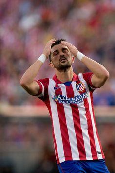 David Villa of Atletico de Madrid reacts as he fail to score during the La Liga match between Club Atletico de Madrid and Malaga CF at Vicen...