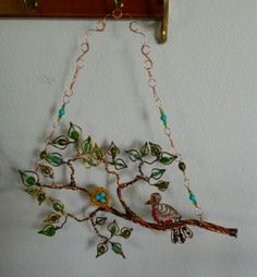 Tree branch sun catcher with bird and nest.  Beaded wire wrapped.