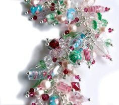 Charm Bracelet loaded with glass pearls and by AprilsViolets, $201.00