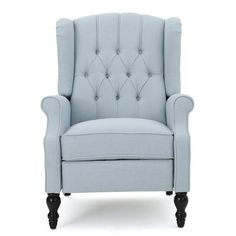 Perfect accenting your parlor or den seating group, this handsome recliner features a tufted back and nailhead details.