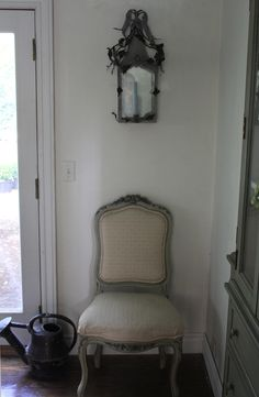 Trouvais ...dining room corner....old metal and French chair