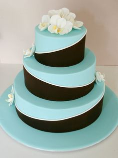The Twist Cake by http://www.rouvelee.com. I would do the tiffany blue with brown instead of black and daisies and carnations