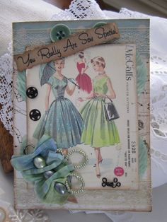 Seamstress Card; love the idea of using pattern packaging in cards (especially with buttons!)