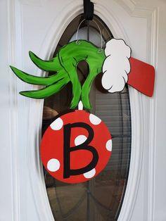 Grinch door hanger is the perfect door hanger that is different from any Christmas door hanger. Grinch Christmas Decorations, Grinch Christmas Party, Christmas Yard Art, Christmas Wood, Outdoor Christmas, Christmas Themes, Christmas Holidays, Christmas Wreaths, Etsy Christmas
