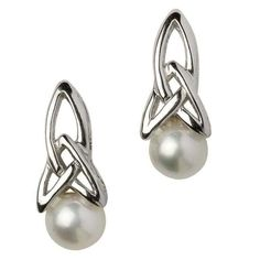 These earrings create the graceful illusion of elongated, sterling silver Trinity knots grasping iridescent pearls. The combination of neutral colors and natural elements in the design brings a classy simplicity to these earrings, and the partnering of soft and sharp lines heightens their sophistication.The Mystery of the Trinity knotThe Holy Trinity of the Christian faith has always presented a mystery: how can three individual beings merge to form a singular entity. This mystery is also…