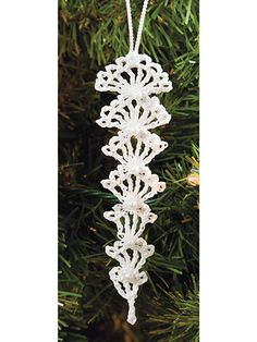 This gorgeous icicles add the perfect handmade touch that your Christmas tree needs! Make a few to fill your own tree and give some as gifts for your friends! Made from size 10 crochet cotton, size steel crochetLacy Joyful Tree Topper free crochet pa Crochet Snowflake Pattern, Christmas Crochet Patterns, Crochet Snowflakes, Holiday Crochet, Crochet Gifts, Crochet Motif, Crochet Flowers, Free Crochet, Crochet Lace
