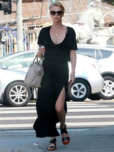 Flaunting a black maxi dress 'n' chic matching sunnies, Charlize Theron grabbed a bite to eat in Los Angeles!