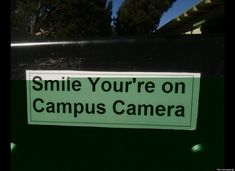 This sign used incorrect spelling with the wrong use of your. It should read Smile your on campus camera. Grammar win!