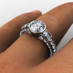 Palladium bezel set diamond graduated engagement ring