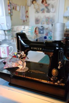 Notice the fancy modern Bernina in the background, behind this gorgeous Singer Featherweight?