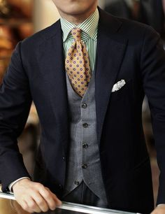 A smart creative combination of patterns and textures makes a suit look just a little less formal, but not less proffesional.